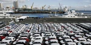 Newly arrived Korean made KIA Sorento SUVs are seen parked at the port of Manila